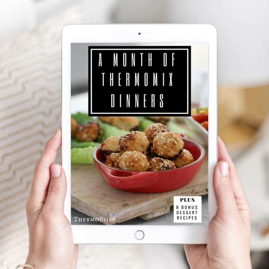 Two hands holding a recipe book - A Month of Thermomix Dinners