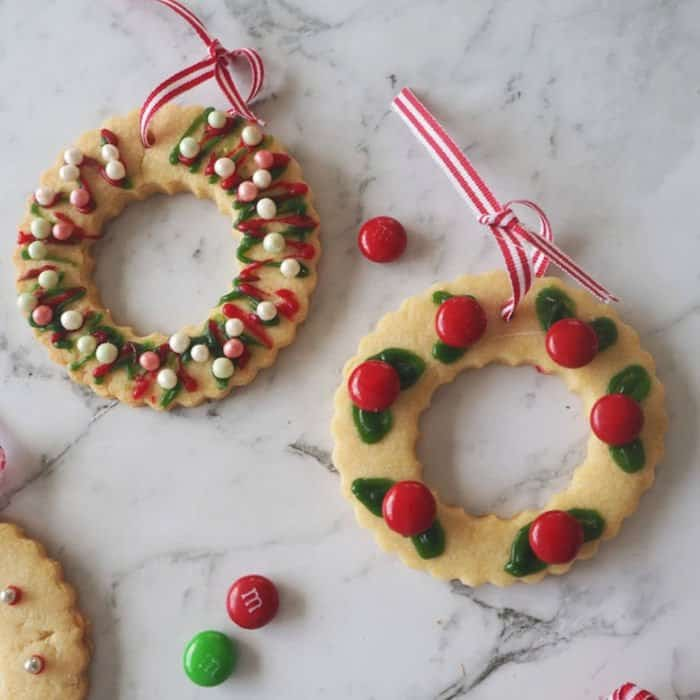 2 Christmas Wreath Shaped Biscuits with Red, Silver and Green decorations.