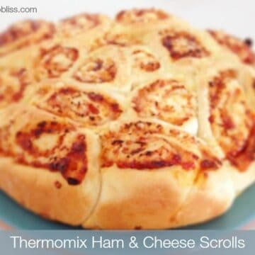A baked pull-apart scroll with ham and cheese rolled through.