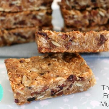 A pile of muesli bars filled with nuts, seeds and dried fruit.