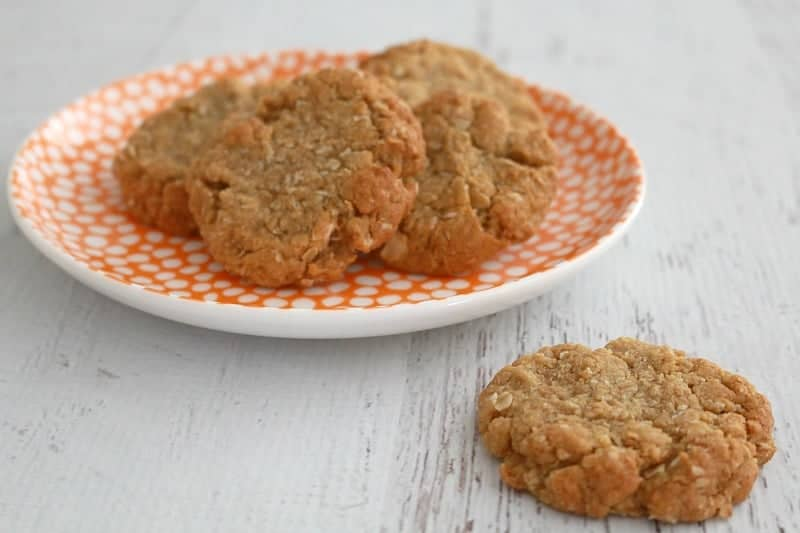 A plate of golden crunchy Anzac biscuits made with rolled oats.