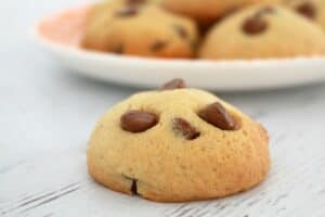 A close up of chocolate chips baked through golden cookies.