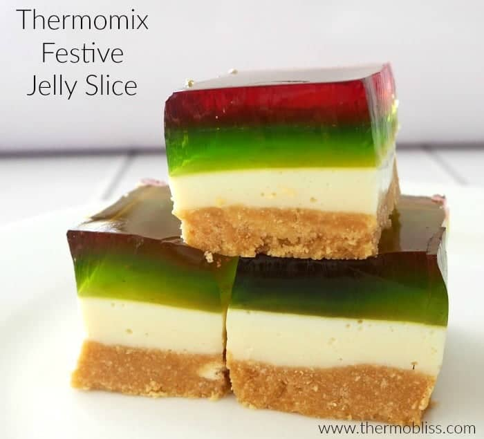 Red and green jelly layers on pieces of a jelly slice.