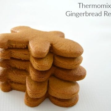 A stack of baked gingerbread men ready to be decorated.