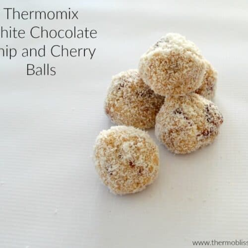 A pile of five white chocolate chip and cherry balls.