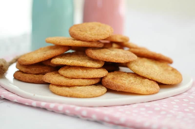 A pile of thin golden snickerdoodle cookies.
