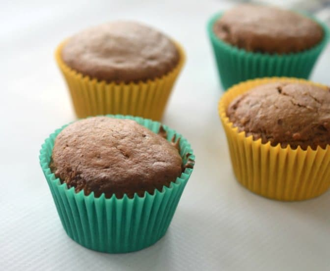 A close up of chocolate muffins in coloured muffin cases.