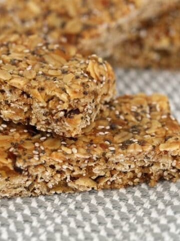 A pile of muesli bars filled with oats and seeds