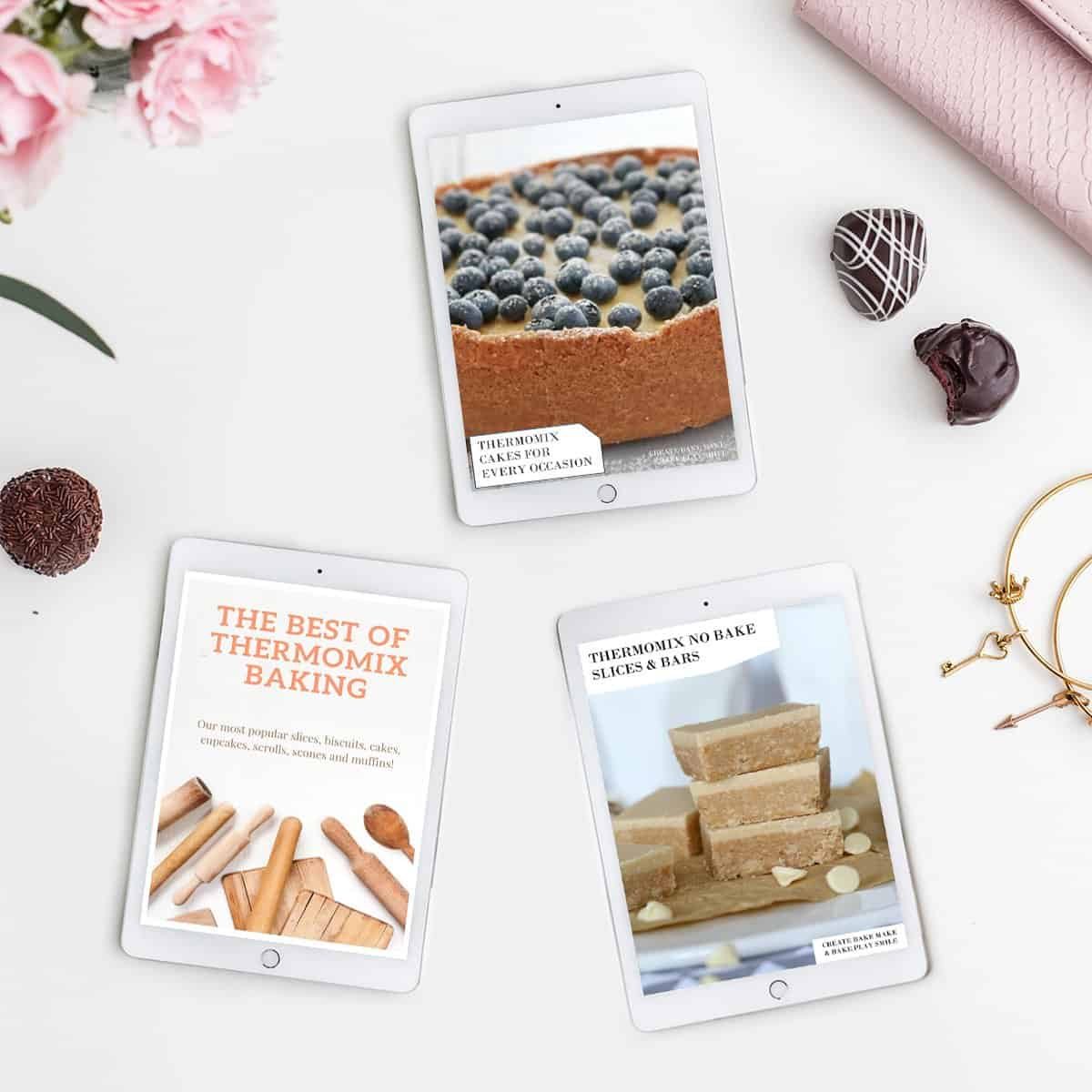 Three recipe books on a bench - Thermobliss Baking Bundle.