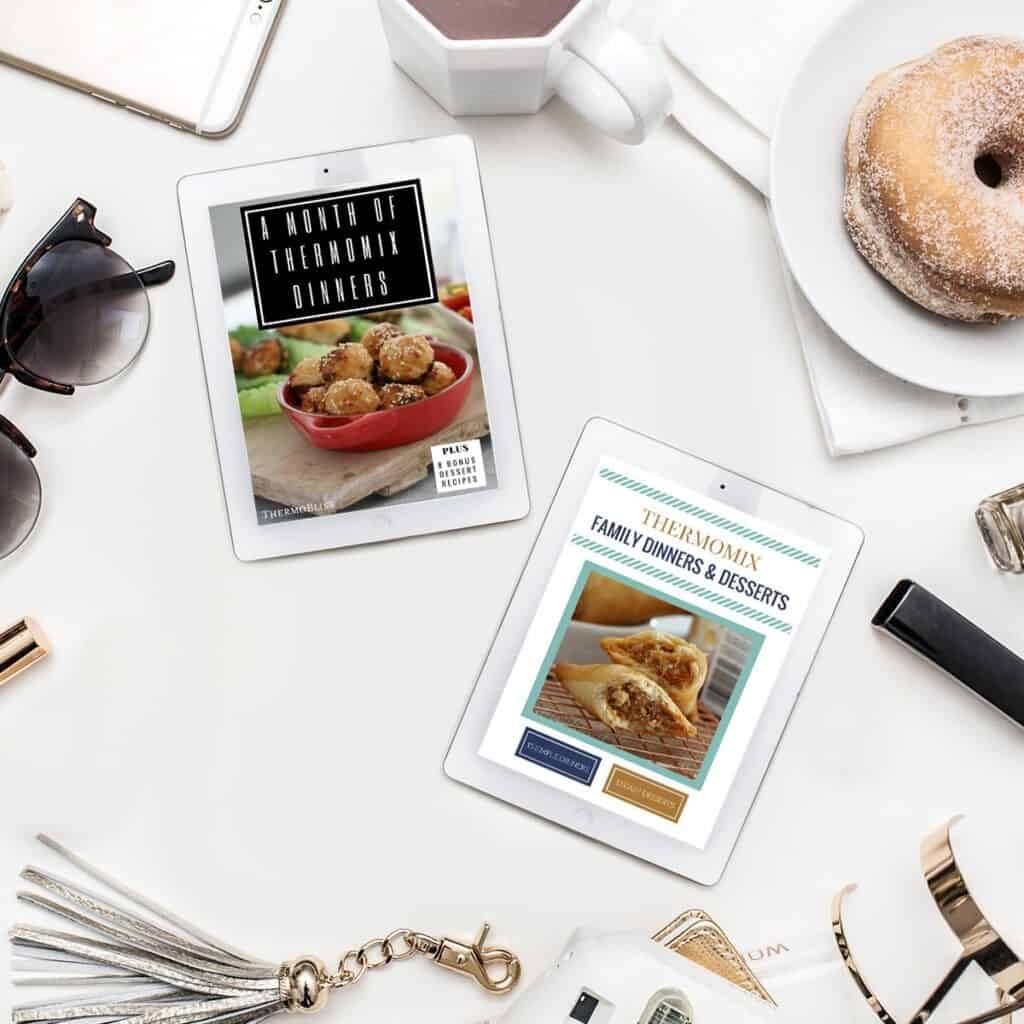 2 ipads displaying Ebooks. A month of Thermomix dinners and Thermomix family dinners and dessert. Ipads surrounded by a doughnut on a plate, A cup of coffee, sunglasses and a tassled key chain.