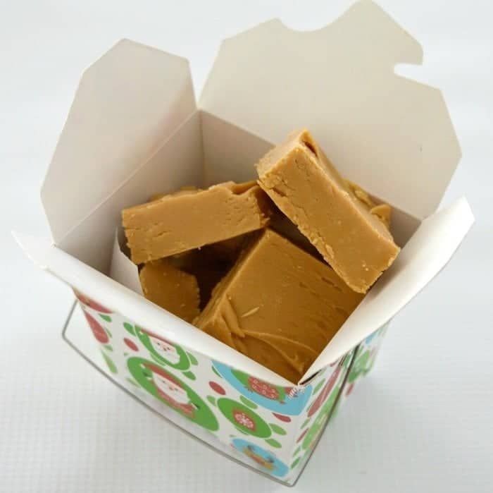 A box filled with caramel coloured fudge squares.