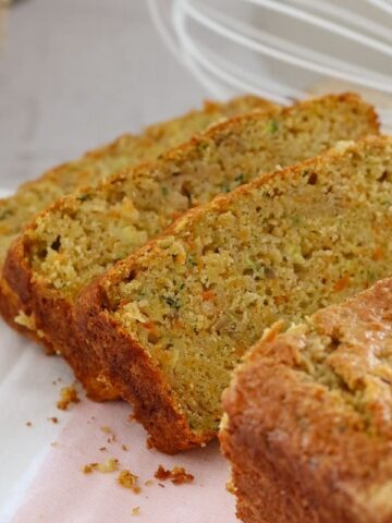 Cut slices of a loaf made with apple, carrot and zucchini.