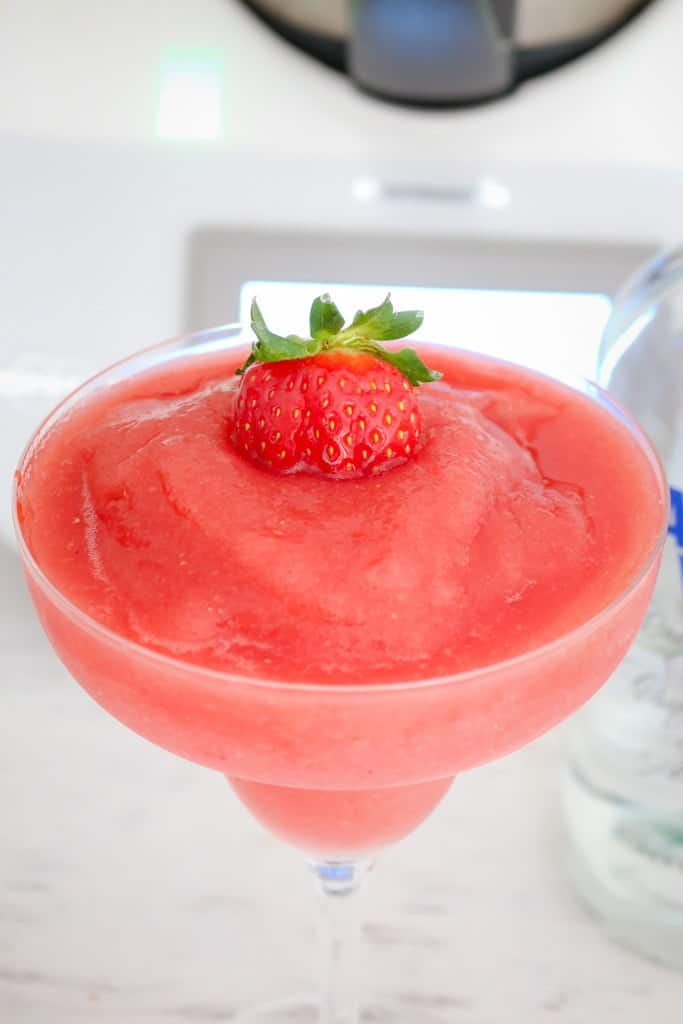 Our Thermomix Strawberry Vodka Slushies are the perfect summer drink! Boozy, fruity and totally ice cold!