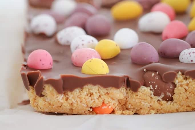A simple Thermomix Easter Egg Slice filled with yummy chocolate Easter eggs... and it's completely no-bake!!