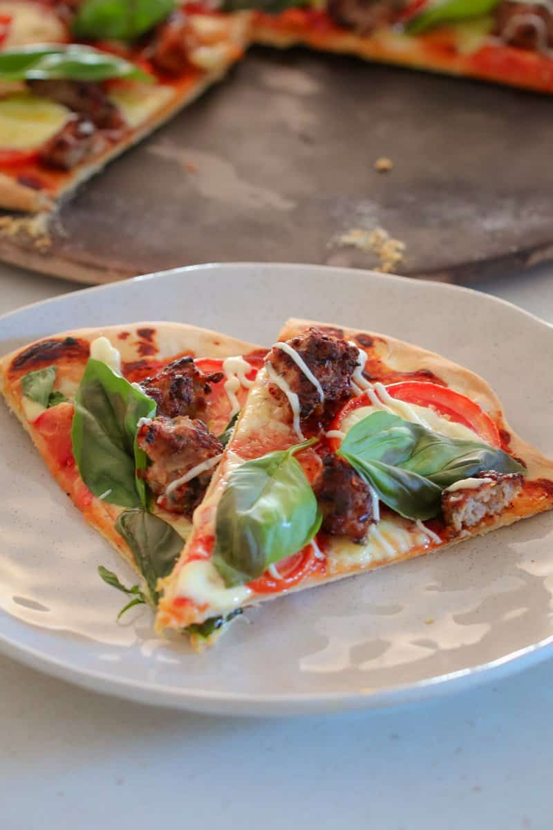 A deliciously crispy Thermomix Italian Sausage, Tomato & Basil Pizza... the perfect recipe for pizza night! This is a guaranteed family favourite!