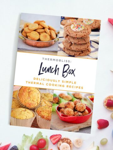 A ThermoBliss 'Lunch Box' recipe book on a bench