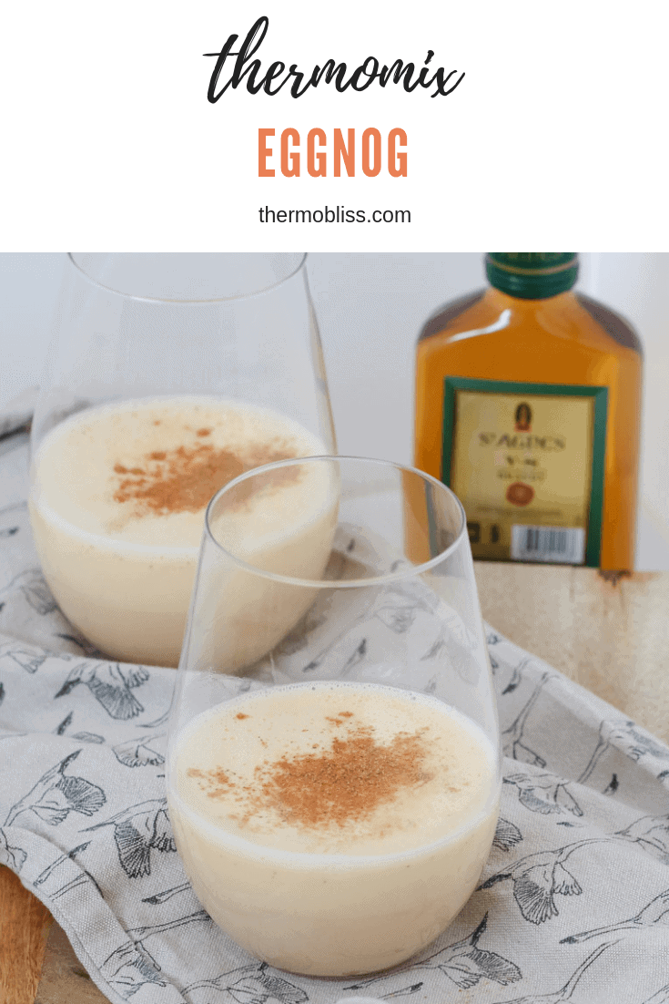 A glass filled with creamy liquid and sprinkled with nutmeg.