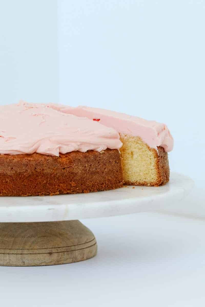 A piece of cake with pink icing.