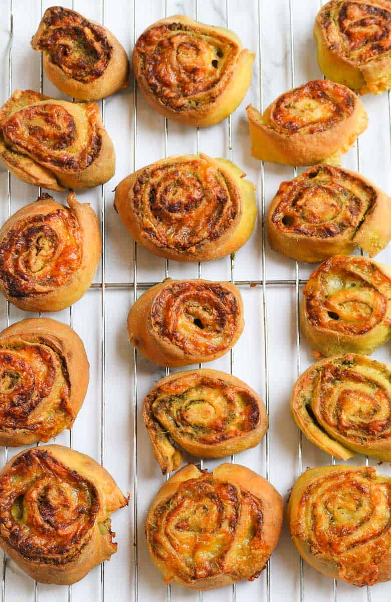 A tray of baked savoury scrolls.