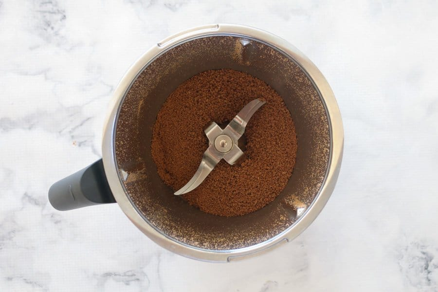 A Thermomix bowl with grated chocolate.