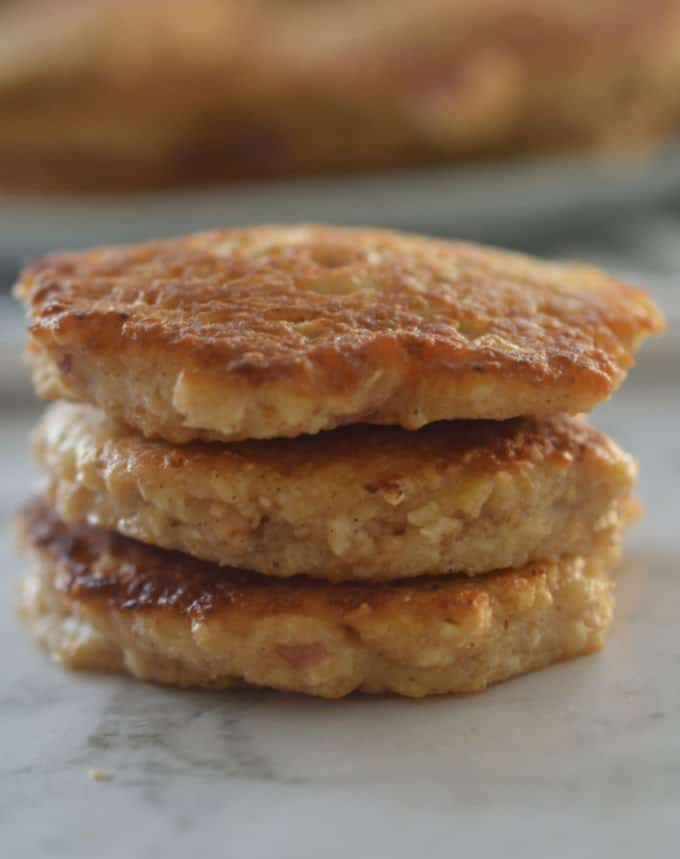 A close up of a stack of three apple and oat pikelets