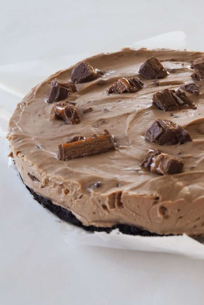A chocolate cheesecake with chunks of Mars Bars on top