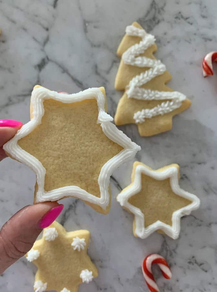 Decorated sugar cookies in Christmas shapes of stars and a Christmas tree