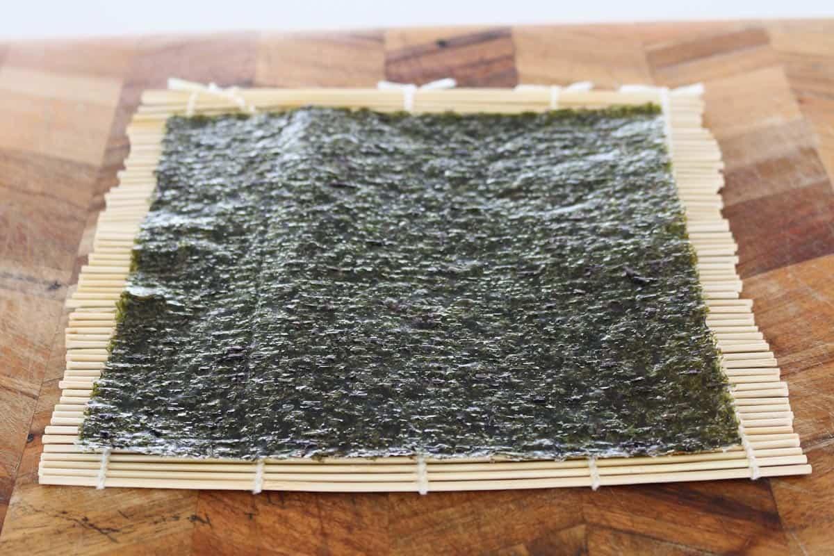 A nori sheet on a bamboo mat.