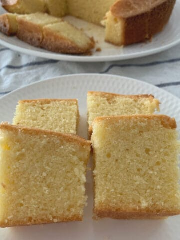 Pieces of a vanilla pound cake cut and served on a white plate