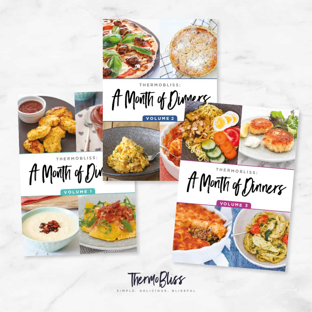 A collection of three 'A Month of Dinners' recipe books