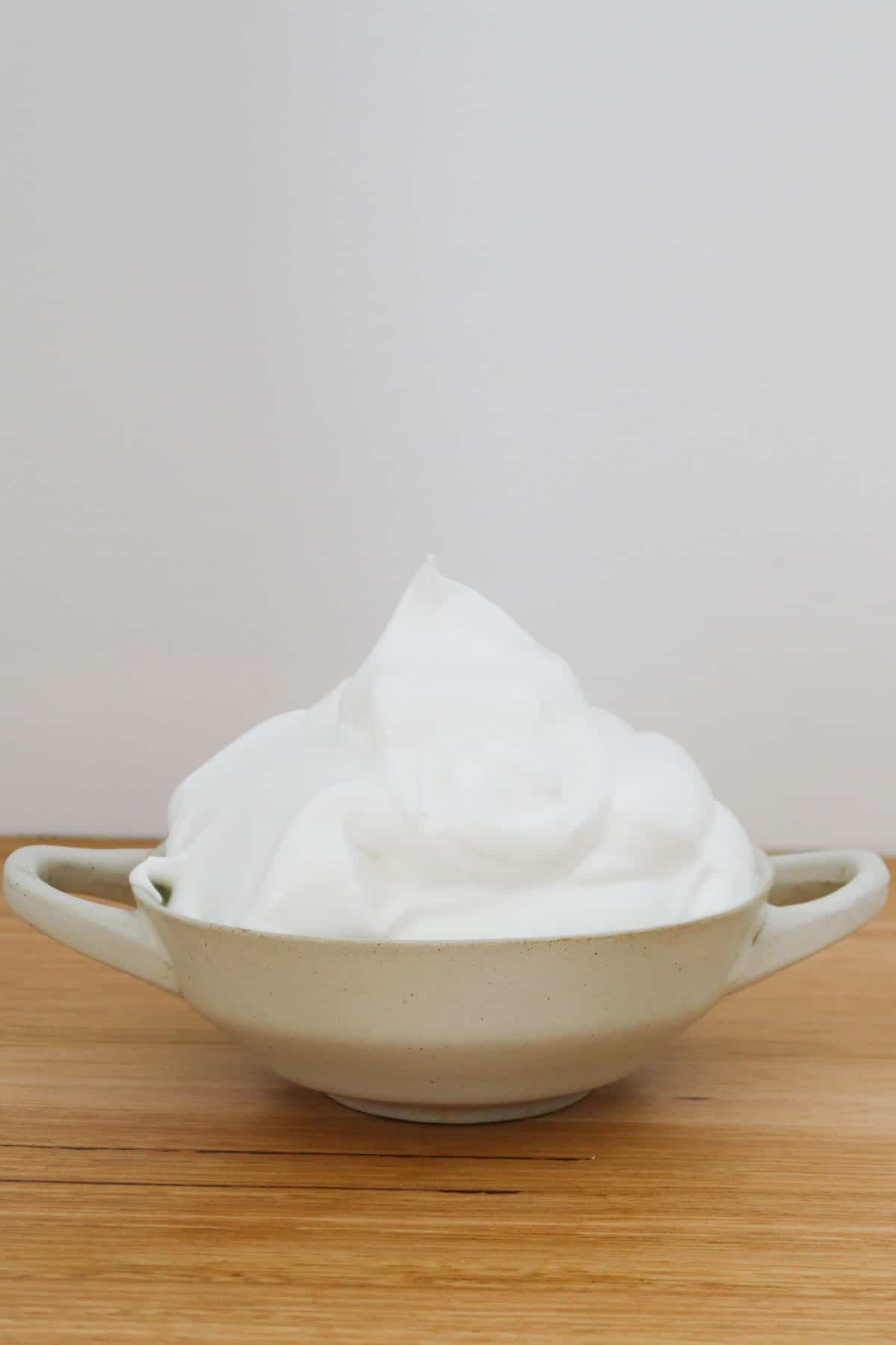 A bowl filled with creamy meringue.