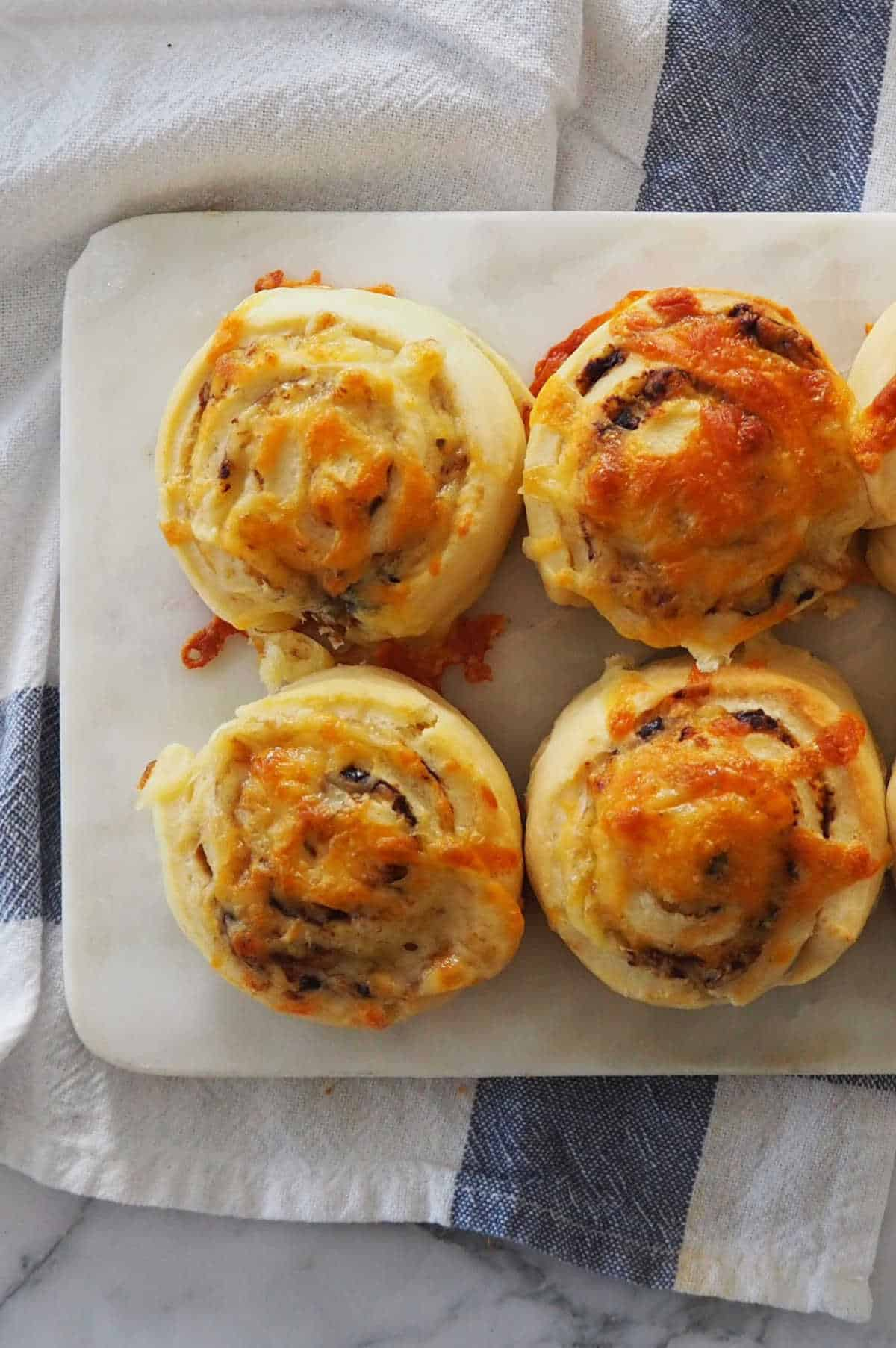 vegemite and cheese scrolls on platter