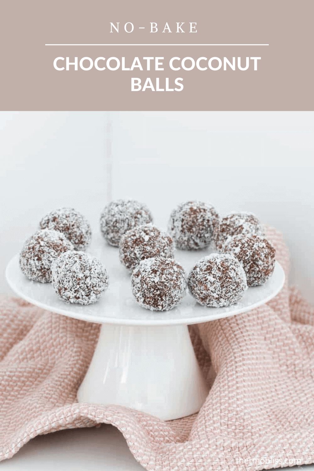 A white cake stand with balls made from biscuits and coconut.
