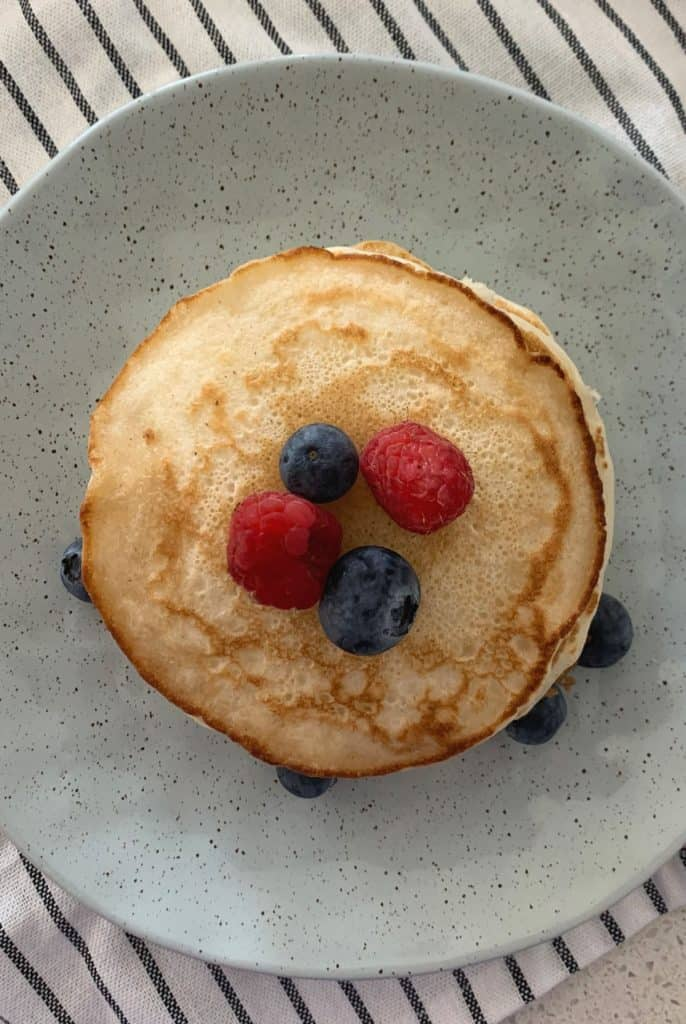 Pancake stack on plate with berries