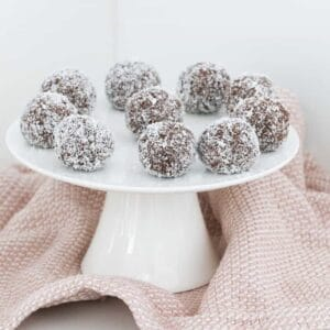 A plate of coconut balls made with cocoa, biscuits and sweetened condensed milk.