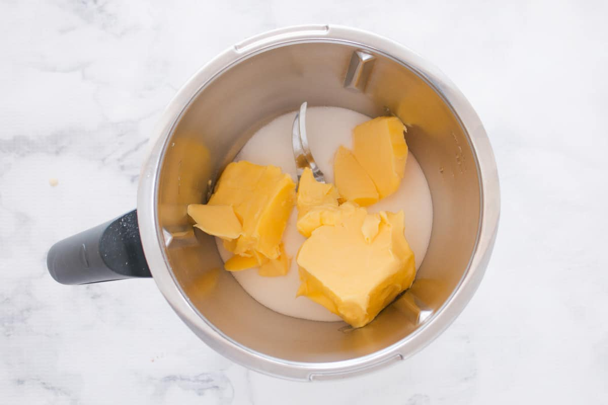 Butter and sugar in a Thermomix bowl.