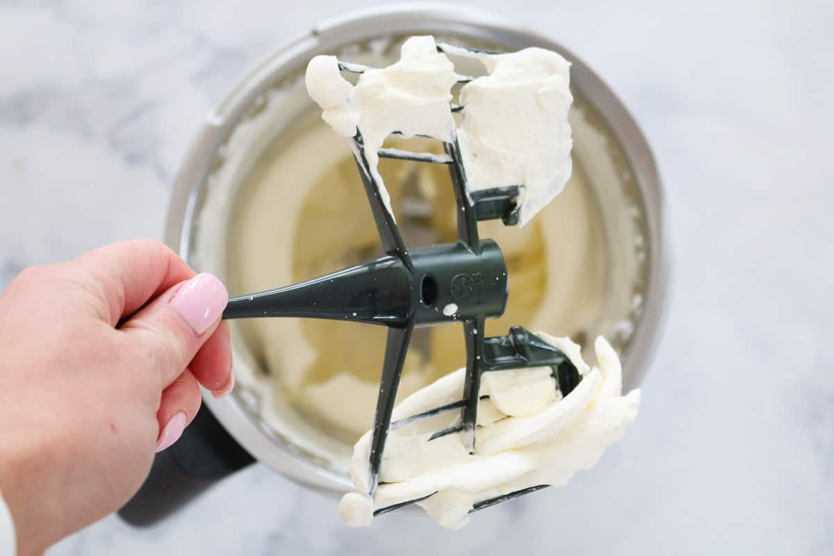 Whipped cream on a Butterfly attachment from a kitchen machine.