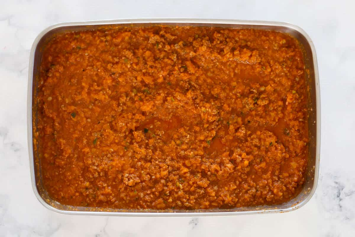 Thermomix chunky bolognese sauce in a stainless steel container.