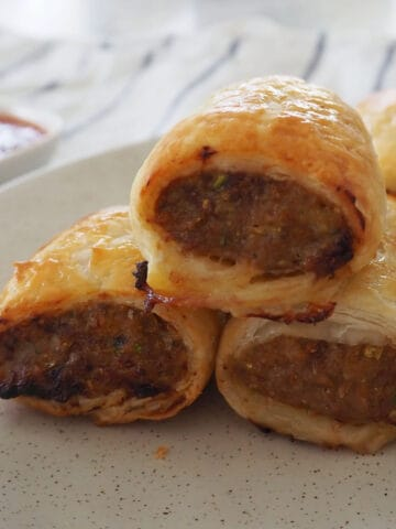 sideview of stack of homemade sausage rolls