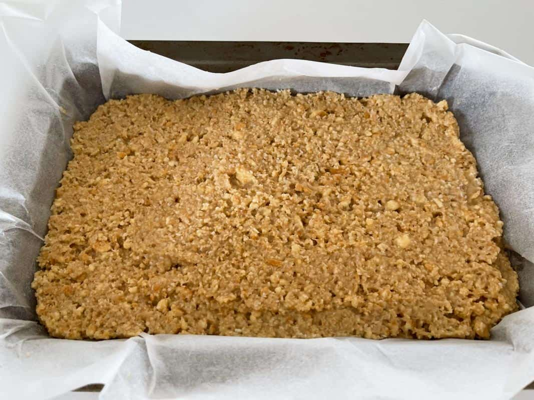 A biscuit crumb slice in a rectangular baking tin.
