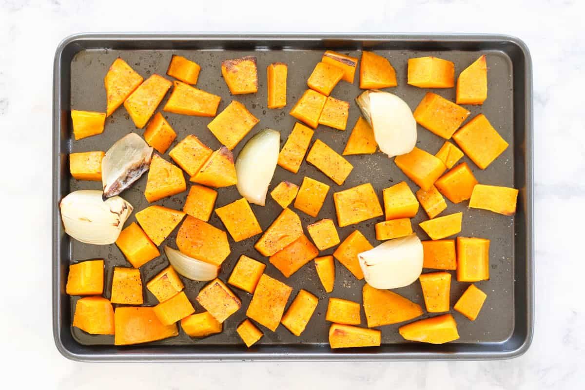 A tray of roasted pumpkin and onion.