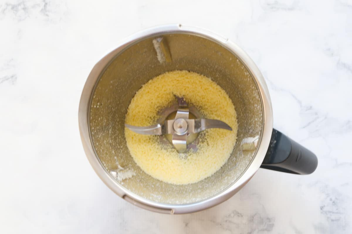 Grated parmesan in a stainless jug.