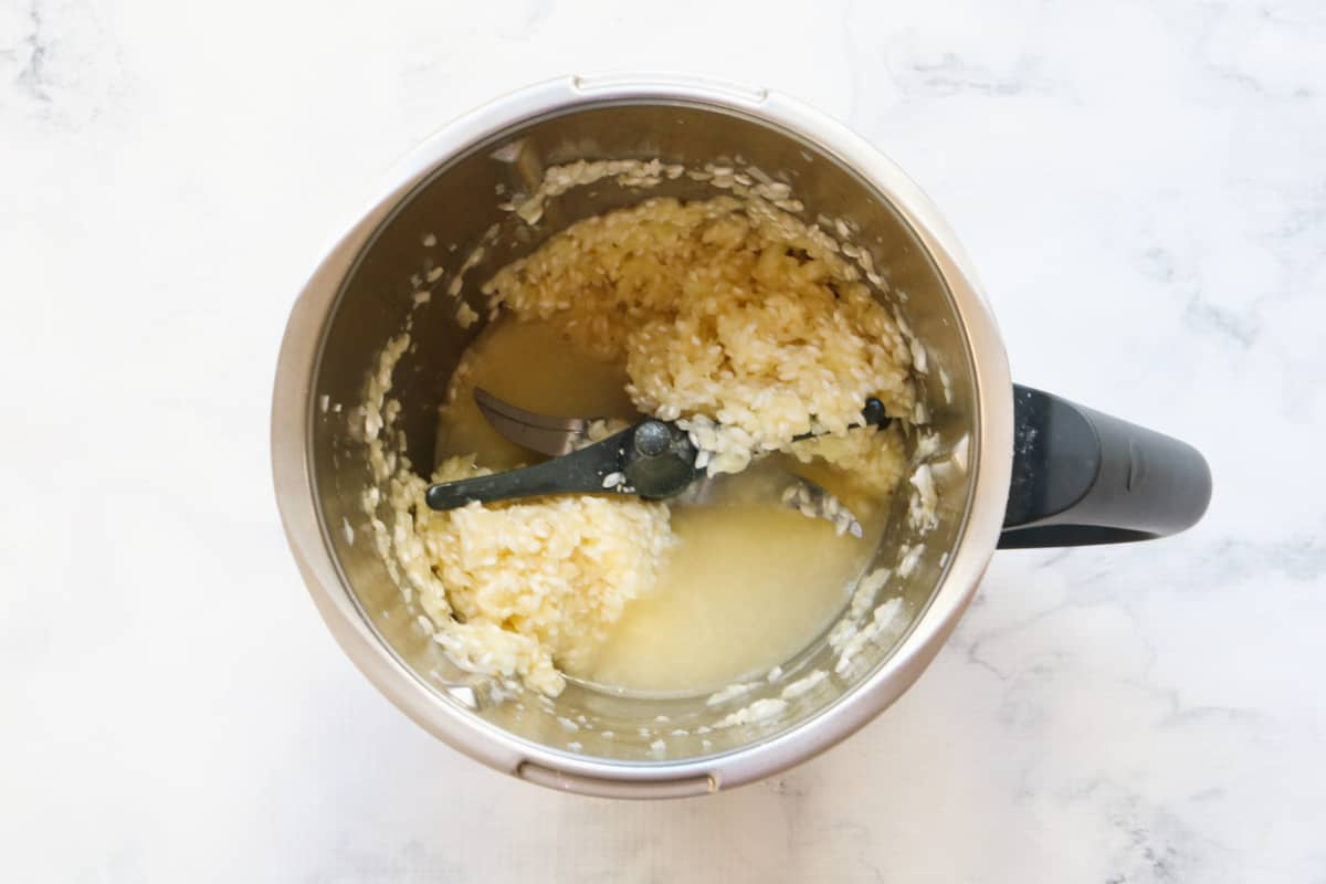 Rice and stock in a stainless jug.