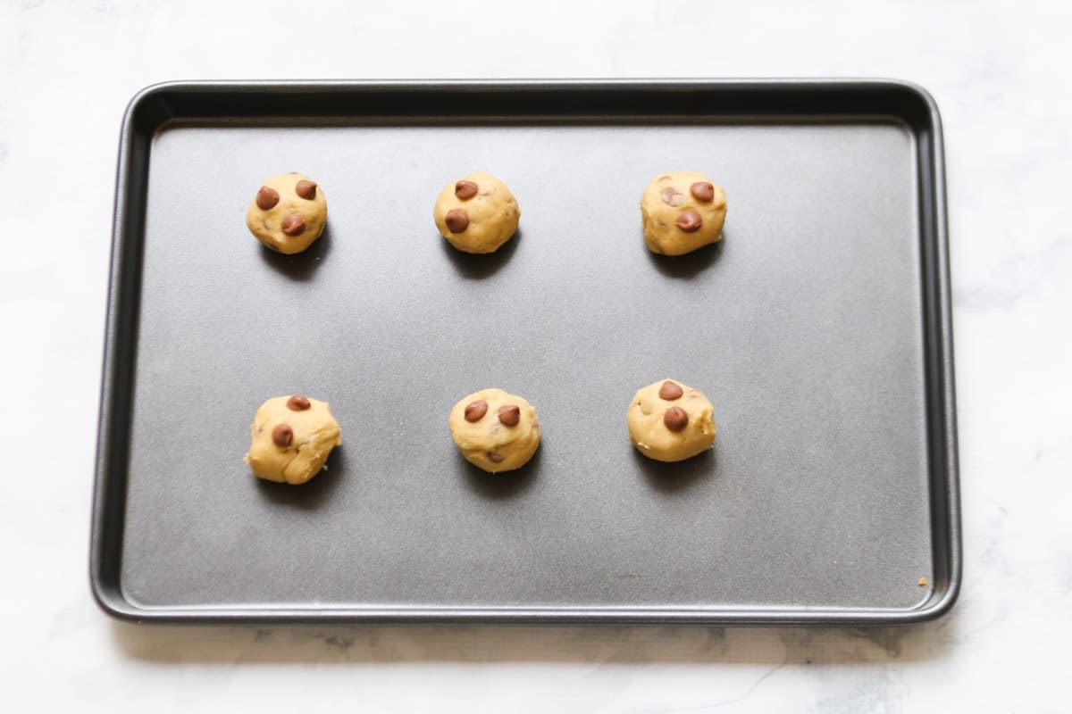 Chocolate chip cookies on a baking tray.